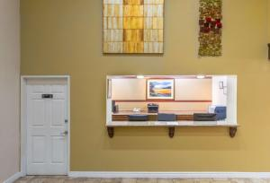 A television and/or entertainment center at Super 8 by Wyndham Goodyear/Phoenix Area