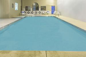 The swimming pool at or near Super 8 by Wyndham Gallipolis Pt Pleasant Area