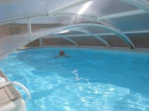 The swimming pool at or near La Chambre D'amis LA COSTIGNIERES