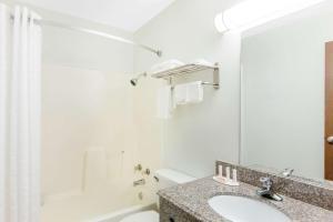 A bathroom at Super 8 by Wyndham Sallisaw