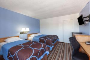 A bed or beds in a room at Super 8 by Wyndham Santa Barbara/Goleta