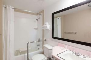 A bathroom at Super 8 by Wyndham Santa Barbara/Goleta