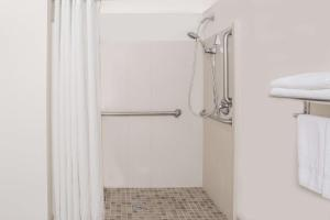 A bathroom at Super 8 by Wyndham Camp Springs/Andrews AFB DC Area