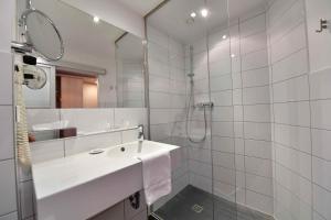 Ein Badezimmer in der Unterkunft Hotel Aspethera