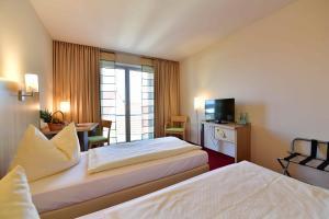 Ein Bett oder Betten in einem Zimmer der Unterkunft Hotel Aspethera