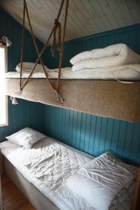 Säng eller sängar i ett rum på Falu Vildvattenpark