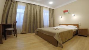 Кровать или кровати в номере Гостиница Orange House