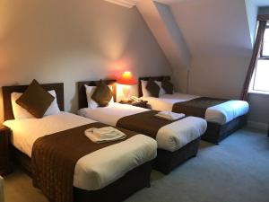 A bed or beds in a room at Abbey Court