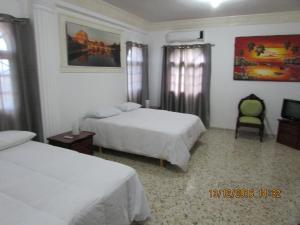 Ein Bett oder Betten in einem Zimmer der Unterkunft Castillo Romano