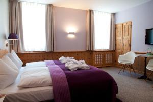 Ein Bett oder Betten in einem Zimmer der Unterkunft Hotel Rosatsch