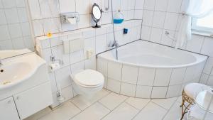 A bathroom at Hotel Alpha