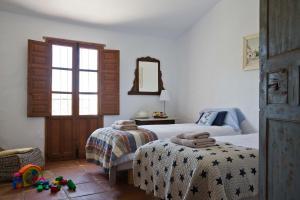 A bed or beds in a room at Cortijo Juan Salvador