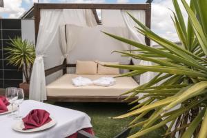 Cama o camas de una habitación en Hotel Macami
