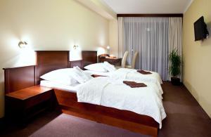 Ein Bett oder Betten in einem Zimmer der Unterkunft Hotel Park