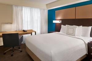A bed or beds in a room at Residence Inn by Marriott Toronto Airport