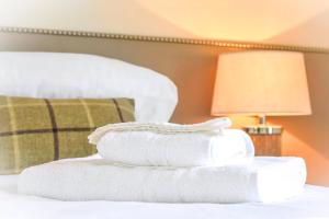 A bed or beds in a room at The Devonshire Arms