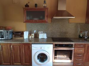 A kitchen or kitchenette at Casa Ruso