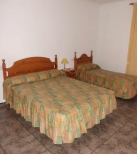 Cama o camas de una habitación en Hostal El Mirador