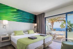 Cama o camas de una habitación en Garden & Sea Boutique Lodging