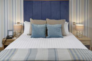 A bed or beds in a room at Best Western Princes Marine Hotel