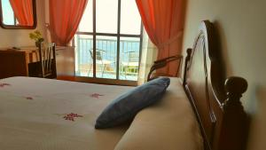 A bed or beds in a room at Hotel Soremma