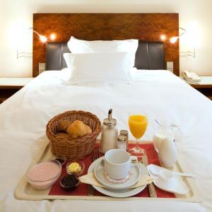 Кровать или кровати в номере Grand Hotel Mussmann