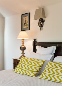 A bed or beds in a room at Demeure Castel Brando Hôtel & Spa
