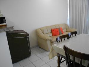 A seating area at Apartamento Maximum