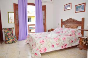 A bed or beds in a room at Magnu´s Pousada