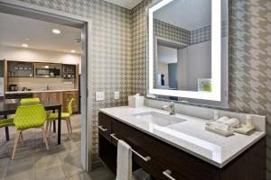 A bathroom at Home2 Suites By Hilton Texas City Houston