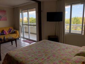 A bed or beds in a room at Blue Marlin Resort