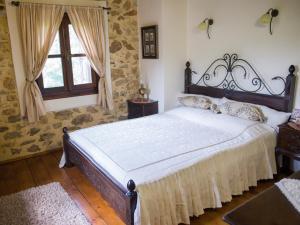 Ένα ή περισσότερα κρεβάτια σε δωμάτιο στο Villa Archontiko