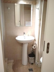 A bathroom at Liza's ground floor apartment