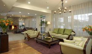 The lobby or reception area at Cilene del Faro Suites & Spa