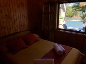 Una cama o camas en una habitación de Costa del Sol Iguazú