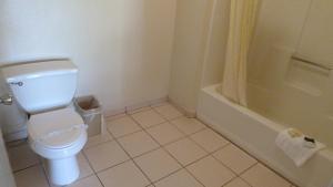 A bathroom at Ambassador Inn Fresno