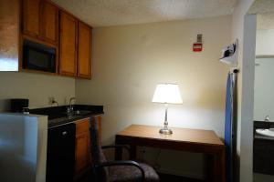 A kitchen or kitchenette at Ambassador Inn Fresno