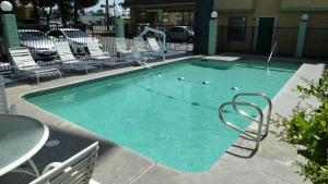 The swimming pool at or near Ambassador Inn Fresno