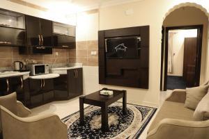 A cozinha ou cozinha compacta de Amasy Al-Bashaer