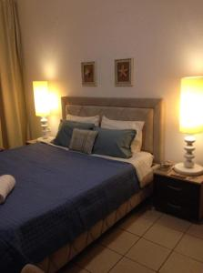 A bed or beds in a room at GreeceRent - LADADIKA