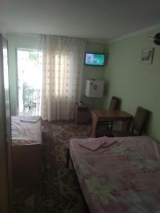 Кровать или кровати в номере Мини гостиница Престиж.