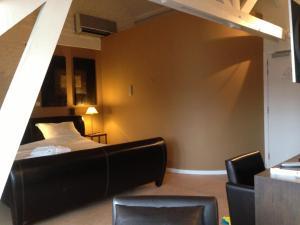 Een bed of bedden in een kamer bij Hotel Orion