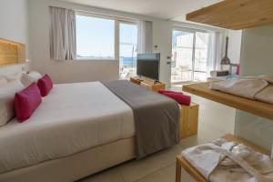 A bed or beds in a room at One Ibiza Suites