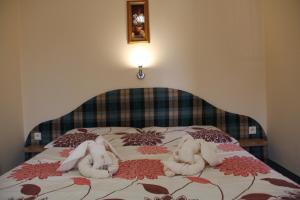 Postel nebo postele na pokoji v ubytování Villa Laura