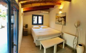 Ένα ή περισσότερα κρεβάτια σε δωμάτιο στο Villa Cavour