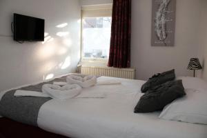 Een bed of bedden in een kamer bij Hotel Berg en Bos