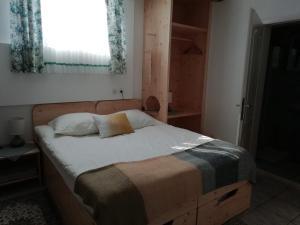Ein Bett oder Betten in einem Zimmer der Unterkunft Mama's House