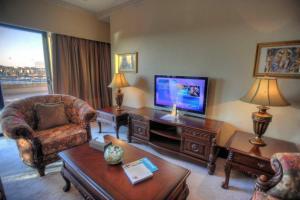 Télévision ou salle de divertissement dans l'établissement Grand Hotel Excelsior