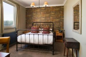 A bed or beds in a room at Penventon Park Hotel