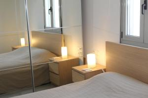 A bed or beds in a room at Ferienhaus Mare Cottage